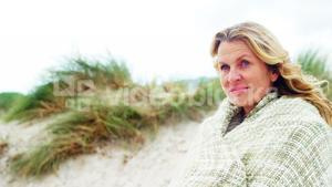 Happy mature woman in shawl feeling cold