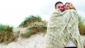 Romantic couple embracing each other in shawl