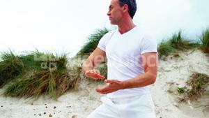Mature man performing stretching exercise