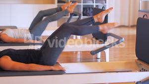 Women exercising on gym equipment