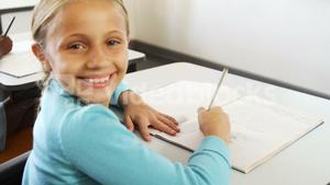 Portrait of girl studying in classroom