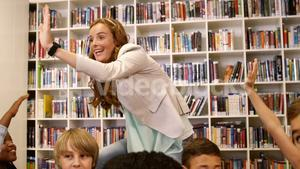 Teacher giving high five to kids in library