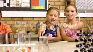 School kids interacting with each other in laboratory