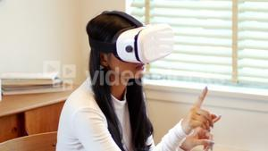 Woman using virtual reality headset in living room