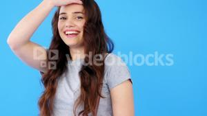 Beautiful woman with hand bag posing on blue background