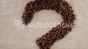 Disposable cup and coffee question mark with coffee beans