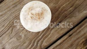 Coffee cup on wooden plank