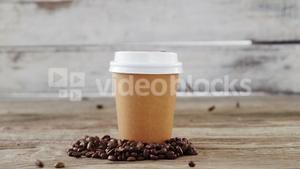 Coffee beans falling on disposable cup