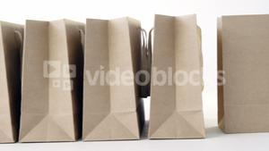 Brown shopping bags on white background