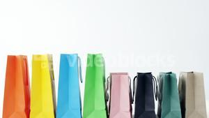 Multicolored shopping bags on white background