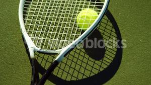 Close-up of tennis racket and ball