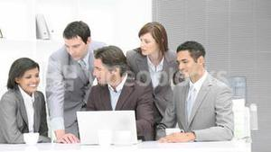 Business people working with a laptop in office