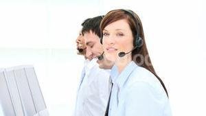 Smiling businesswoman working in a call center