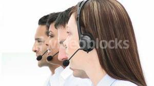 Close up of people working in a call center