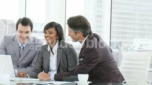 Business team working with a laptop in office