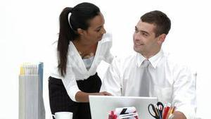 Male and female Employees working together