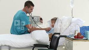 Doctor listening to a childs chest with stethoscope