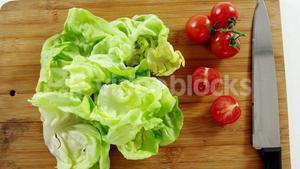 Vegetables and kitchen knife on chopping board