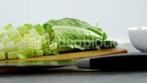Vegetables and kitchen knife on table