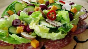 Meat and salad on wooden plate