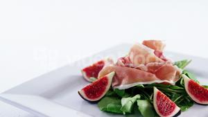 Raw meat and vegetables on plate