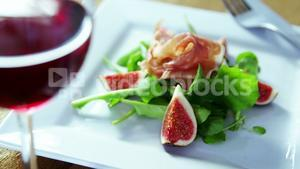 Salad with red wine served on plate