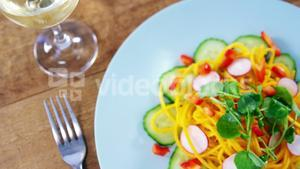 Salad with wine served on plate