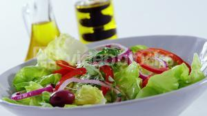 Oil being poured in salad