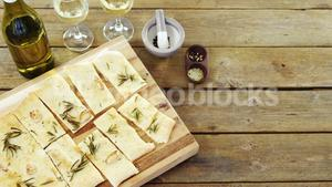 Snacks on tray with glasses of wine and wine bottle