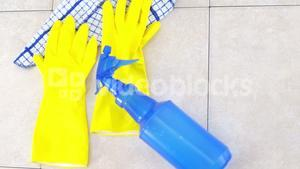 Yellow rubber gloves and spray bottle