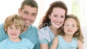 Family Sitting on a sofa at home