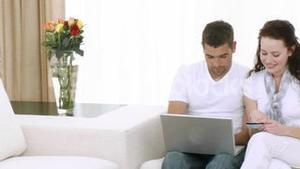 Couple at home using a laptop
