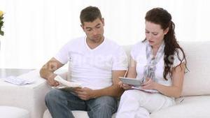Couple at home doing Domestic Bills