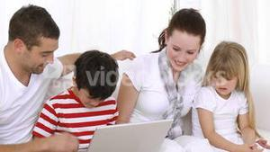 Family at home looking at the internet