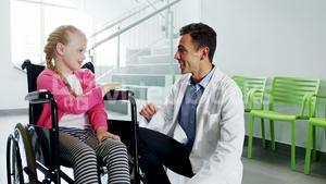 Doctor giving high five to disable girl