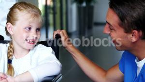 Doctor interacting with disable girl