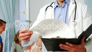 Doctor examining medical report