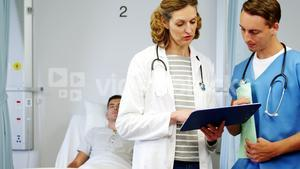 Doctor and nurse discussing on medical report