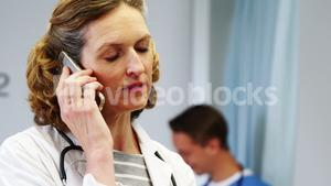 Female doctor talking on mobile phone