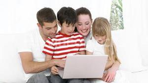 Happy Family at home browsing the net