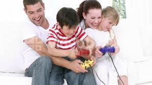 Family at home playing Video games
