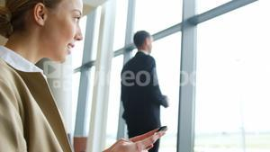 Beautiful woman texting on mobile phone