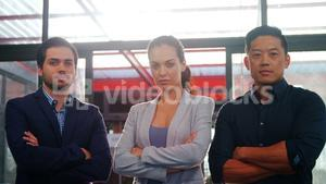 Confident business executives standing in office