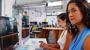 Female business executives working over computer