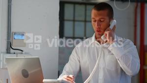 Business executive talking on telephone