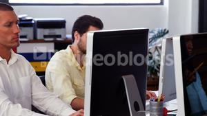 Business executives working at desk