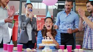 Business executives celebrating birthday of a colleague