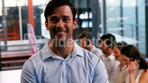 Business executive smiling in call centre
