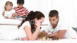 Young Couple Playing Chess in the living room