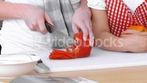 Family preparing food in the Kitchen for dinner